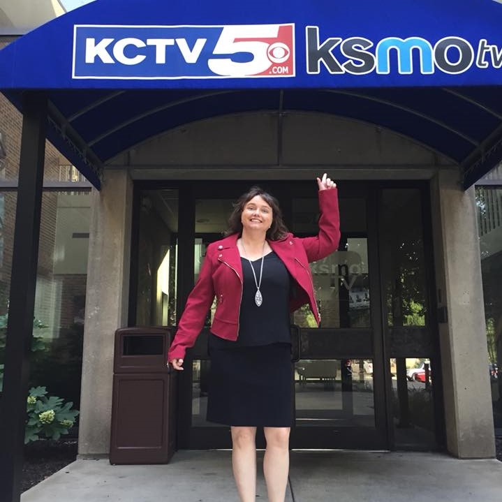 Sr. Susan Harrison stands under the KCTV5 sign before going inside for a guest spot