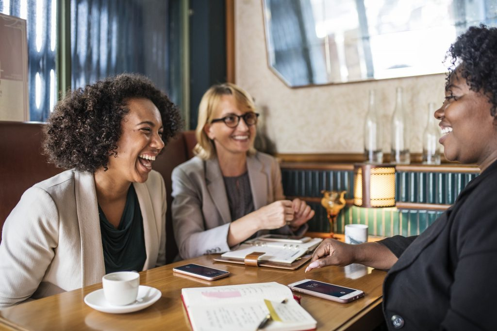 three women meeting in coffee shop