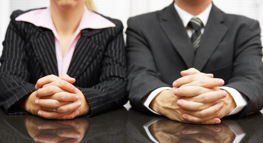businessman and woman's clasped hands
