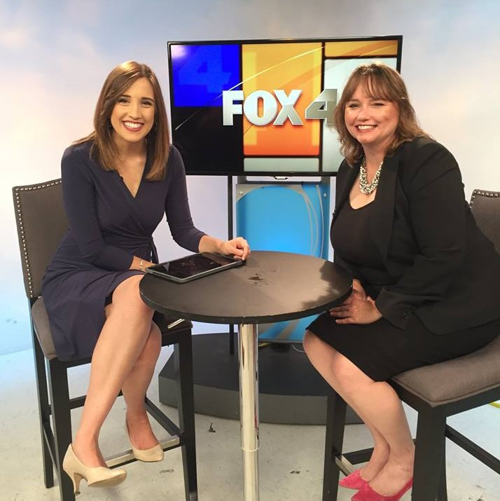Dr. Susan Harrison sits next to Nicole DiAntonio in front of the fox 4 logo on a tv screen